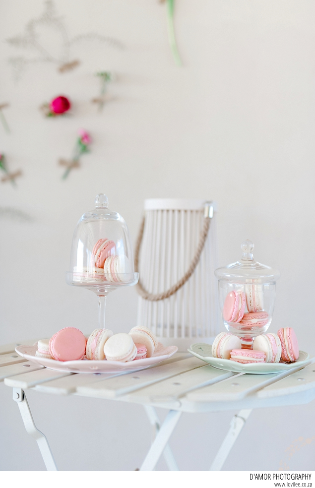 Tea setting complete with macarons and flower wall