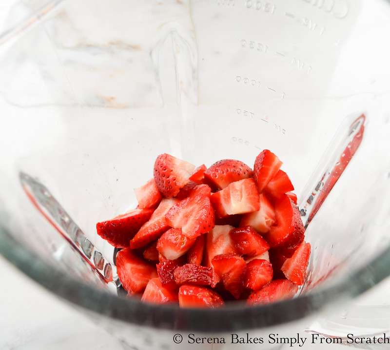 Sliced Fresh Strawberries in a glass blender.