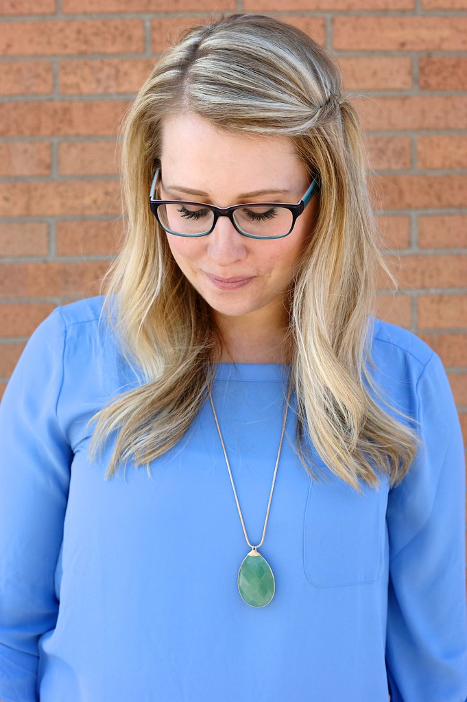 periwinkle blouse and green pendant