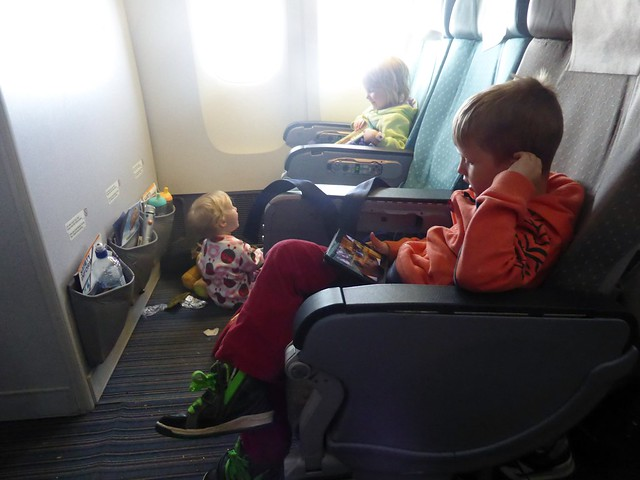 kids on a long haul plane family travel baby