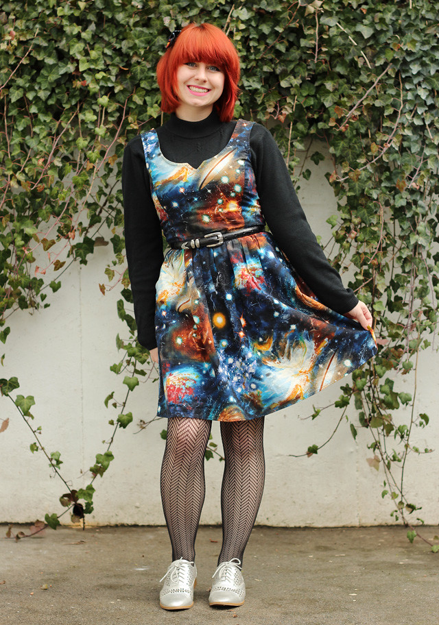 Heart and Solar System Dress over a Black Mock Turtleneck Sweater