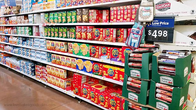 A grocery store isle with Ritz crackers on the shelves.