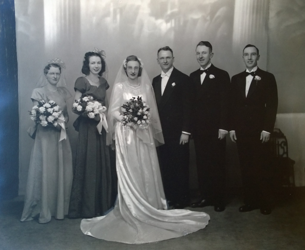 Formal portrait of Grandma, Pop, and their wedding party
