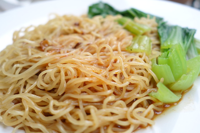 Noodles tossed in sauce at Siang Yuen Traditional Roasts