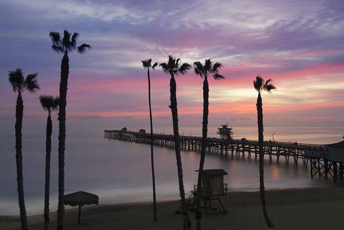 ocean california trees sunset sea sky beach water clouds coast pier pacific palm sanclemente