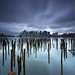 Downtown Boston Skyline over Sea of Decayed Pilings under Stormy Sky, East Boston Massachusetts by Greg DuBois Photography