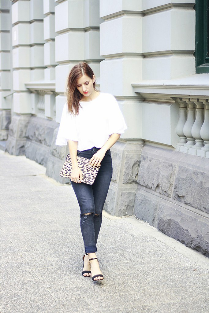 Wearing Ksubi black High waisted jeans