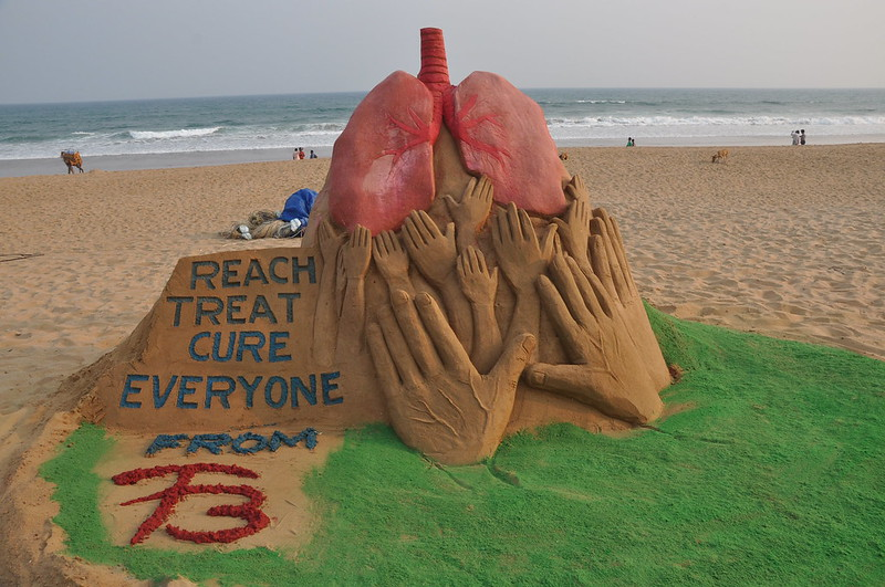 sand sculpture on the eve of World Tuberculosis Day on the Golden sea beach Puri
