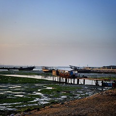 #dawn #scene at the #dhow #graveyard in #Arab #Muharraq #bahrain #lowtide #water #coast