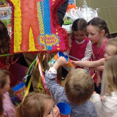 #muno #piñata at the most awesome party today. The girls are conspiring to catch as many goodies as possible.
