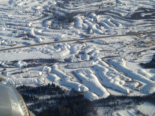 Aerial view of dredging piles outside Dawson City, YT