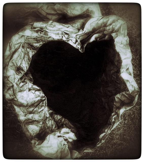 An open sack of charcoal; the opening is in the shape of a heart