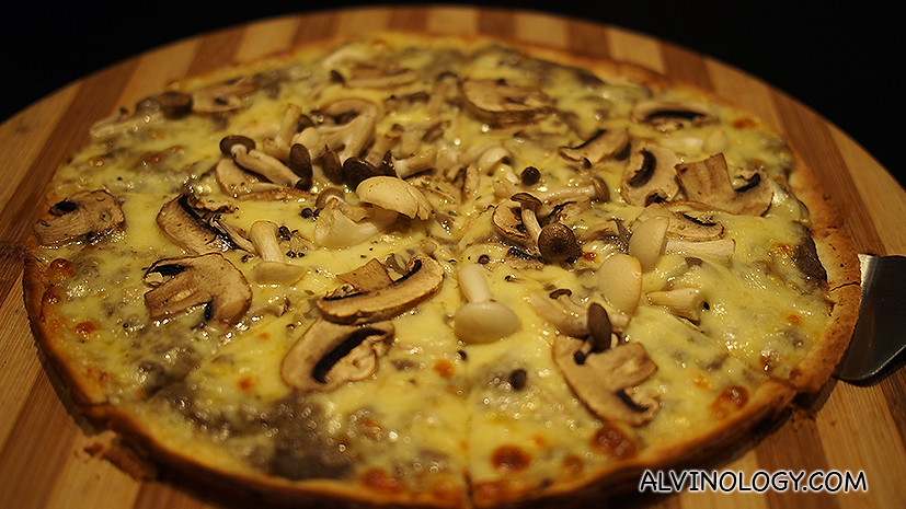 Thin-crust Vege Delight Pizza with mushrooms.