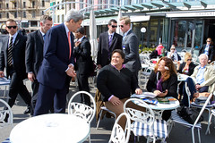 U.S. Secretary of State John Kerry chats with fellow lunch patrons in Lausanne, Switzerland, on March 27, 2015, amid a break in negotiations with Iranian leaders about the future of their nuclear program. [State Department photo/ Public Domain]