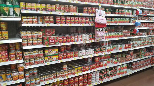 A grocery store isle with RO*TEL Salsa on the shelf.