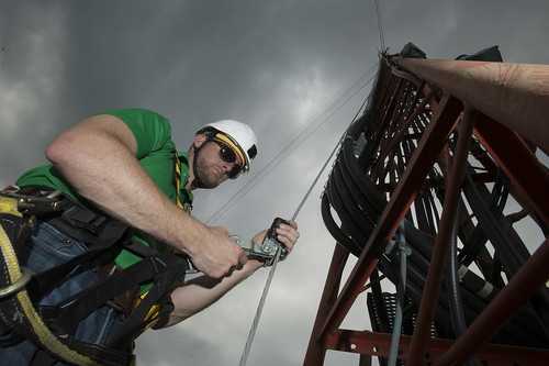 A Pine Net worker prepares to climb a broadband tower in Broken Bow, OK.