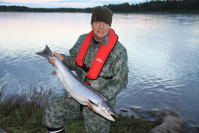 A Fisherman with a big salmon