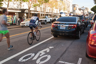 22621 Passing four deep parking dirty in southbound Polk St. bike lane after Green