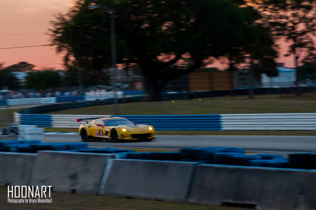 Corvette Racing C7.R racing on Sebring International Raceway at sunset