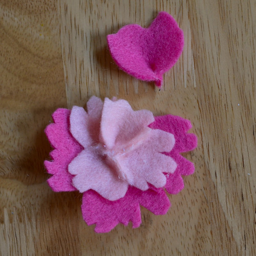 Step 4: Attach larger petals underneath using hot glue at the base