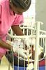 Nurse treats newborn baby inside Neonatal care unit found within Yekatit 12 Hospital Medical College.