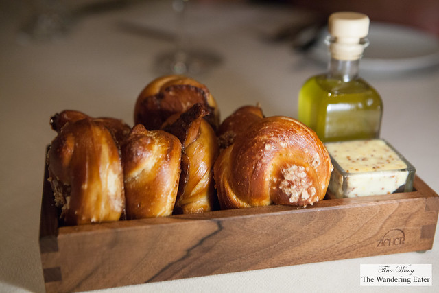 Fresh pretzel rolls with Dijion mustard butter and rosemary oil