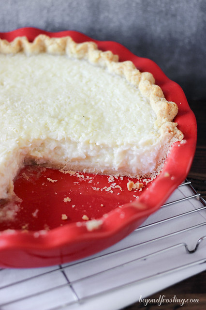 This Old Fashioned Coconut Custard Pie has a perfectly flaky pie crust filled with a baked custard that is loaded with shredded coconut