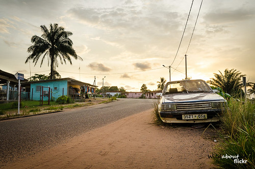 africa road sunset west tree broken car side central down palm tropical smashed wrecked ruined gabon gamba