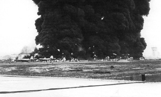 Bien Hoa Disaster (May 16, 1965) - Burning Aircraft on ramp at Bien Hoa AB after explosion
