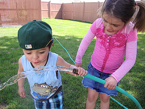 Kids playing with hose