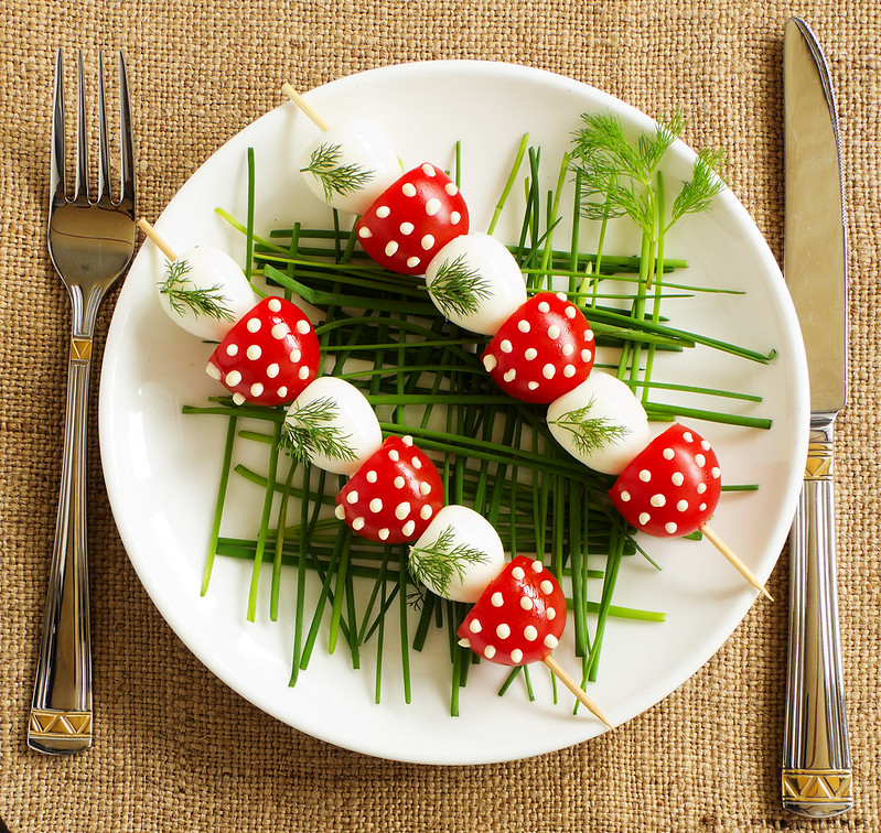 Skewers of quail eggs and tomatoes.