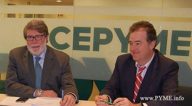 Santiago Aparicio, presidente de CECALE con el presidente de CONFAES, Juan Manuel Gómez.