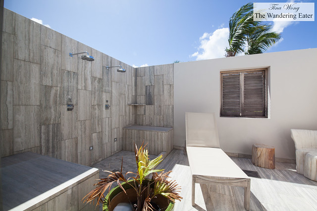 Outdoor covered marble showers at the Four Bedroom Oceanfront Villa