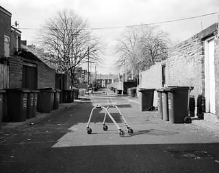 shopping trolley and some bins