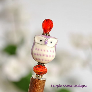 purple owl with red accents