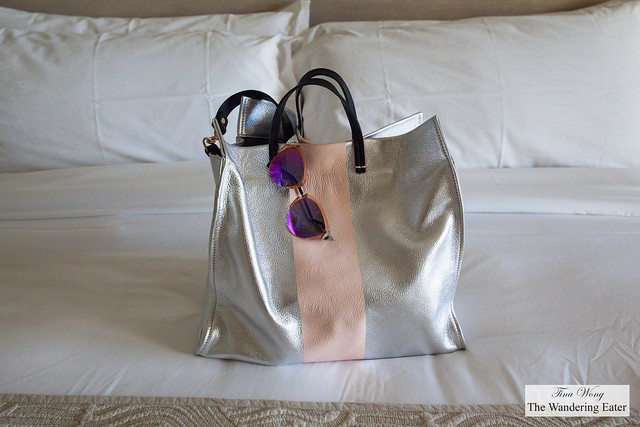 My silver leather Clare V tote and Fendi sungalsses on my spacious bed