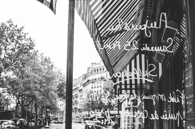 The daily menu, written on a window at a Parisian Cafe.