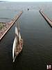 Pride of Baltimore II under the bridge
