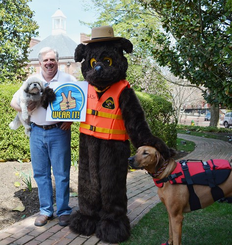 Gov. Larry Hogan and his dog Lexi help welcome Splash, NRP's Water Safety mascot, during a lighthearted weekend ceremony on the Government House lawn.