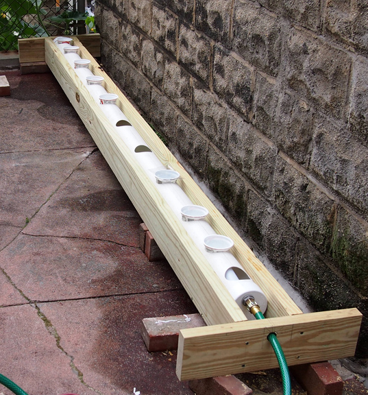 Rain gutter grow system as a raised bed tomatoville for Rain gutter planter box
