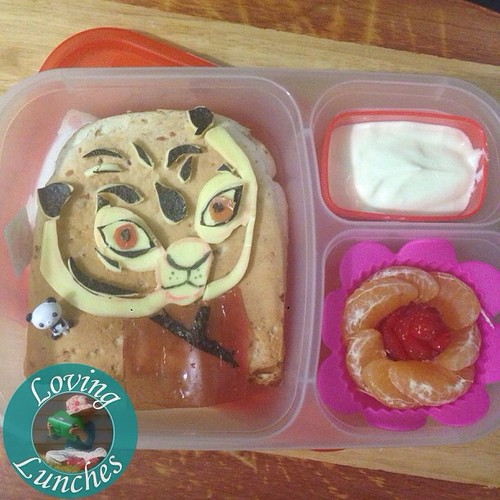 Love love Loving how tomorrow's #Tigress lunch turned out! Our @easylunchboxes has sandwich with #noricutting #cheesart , yoghurt and mandarin strawberry flower. #Dreamworks #KungFuPanda #easylunchboxes