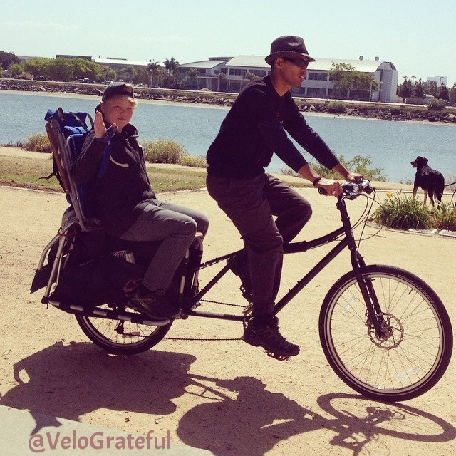 Riding to Gator By the Bay. Nick sprained his right hand. So he's my passenger on the #surly #bigdummy #cargobike