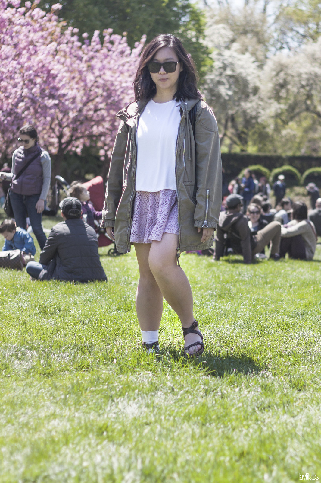 Flowy white LOFT tulip back tank with lacey American Rag skater dress, green TNA parka, and strap up Birkenstock Yara sandals