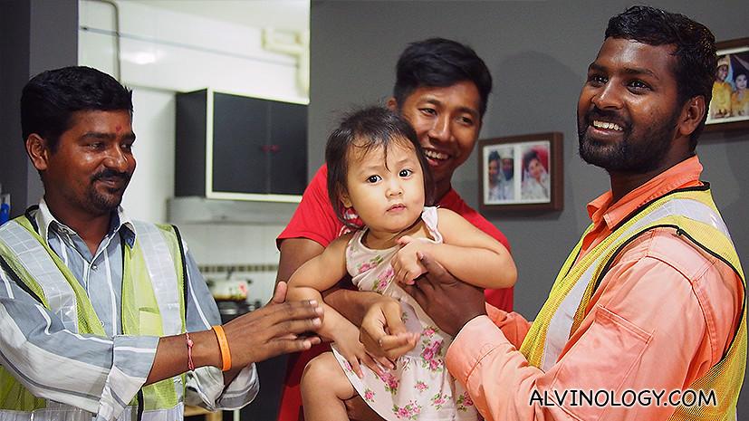 Shanmuganathan and Muthukumar reunite with Naurah; papa Fazlee is holding her.