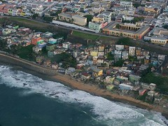 """""""12 Vecinas (12 Neighbors) is the most recent project by Puerto Rican artist Marisol Plard-Narváez (b. 1966, Puerto Rico), it consists of a three hundred and sixty-degree view, twelve channel video installation showcasing the testimonies and anecdotal acc"""