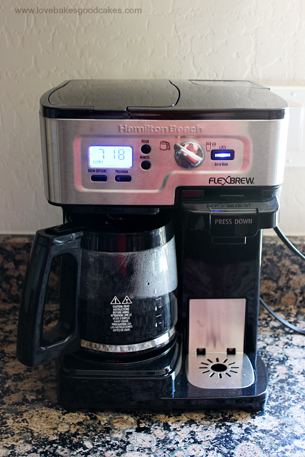 A coffee pot on the counter making coffee.
