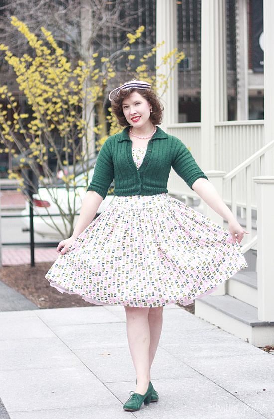 Easter outfit showing off the skirt of a vintage piano novelty print dress