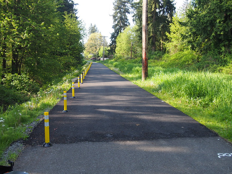 Repaved Interurban Trail: Complete with new plastic bollards highlighting a gully