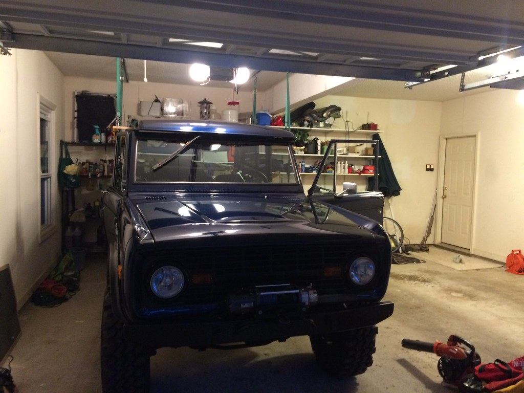 Vwvortex i built a hardtop hoist for my bronco 100 bolts from hardtop i backed the bronco into the garage and passed the boards under the top and hooked up some motorcycle tie downs from each trolley solutioingenieria Gallery