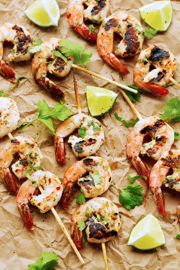 Grilled Cilantro Lime Shrimp Skewers that are perfect for grilling this summer! Easy to make and less than 10 ingredients! #shrimpkabobs #shrimpskewers #grilledshrimp | Littlespicejar.com